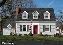 cape cod house with three dormers u0026 red door u2014 stock photo