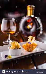 cognac cuisine cake with peas in caramel basket culinary food