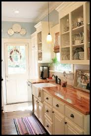 white cabinets with butcher block countertops white cabinets butcher block countertops and pretty blue walls by