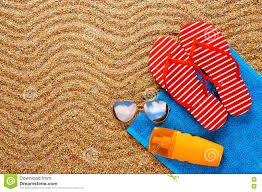 flip flop towel flip flops sunscreen spray and towel on the stock photo