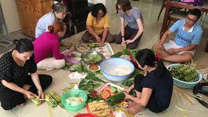 vietnamese people making rice cakes banh tet for viet nam tet in
