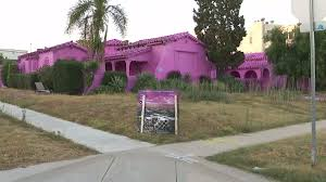 before demolition 3 homes painted shocking pink in mid city art