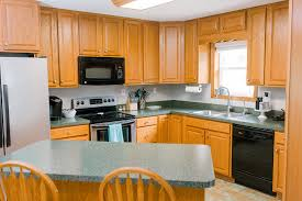 staining kitchen cabinets darker before and after diy kitchen cabinet transformation call us the canterburys