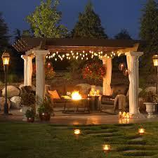 a very nice outdoor patio setup with a huge pergola plus i like