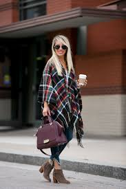 plaid cape for fall worn with frayed hem jeans and booties