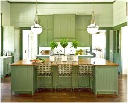 green cabinets installed in the kitchen with butcher block