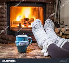 warming relaxing near fireplace woman feet stock photo 487999009