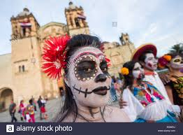 How To Paint A Skeleton Face For Halloween by A Woman Wearing Skeleton Face Paint Poses In Costume During The