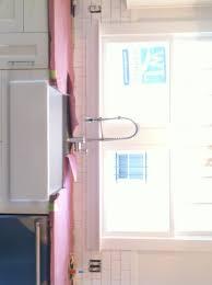 kitchen lighting over sink diy outdoor kitchen ideas bathroom sinks with cabinets medicine
