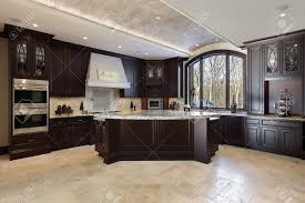 Kitchens With Dark Wood Cabinets by Large Kitchen In Luxury Home With Dark Wood Cabinetry Stock Photo