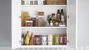 kitchen food storage cupboard how to organize your kitchen cabinets the container store