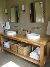 Furniture Bathroom by Simple Round Sinks And Wicker Baskets On Minimalist Wooden