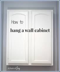 how to hang a cabinet to the wall how to hang a wall cabinet the easy way a pinch of