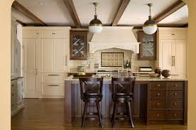 Staining Kitchen Cabinets Darker by Dark Stained Kitchen Island With Brown And Gold Granite