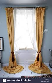 curtains in a bathroom in a georgian townhouse uk stock photo