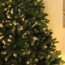 lit real feel pe fir green tree warm white leds