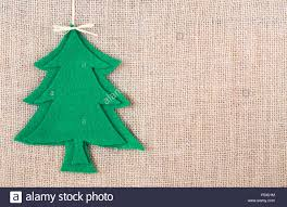 rustic christmas image with christmas tree cut out of felt on