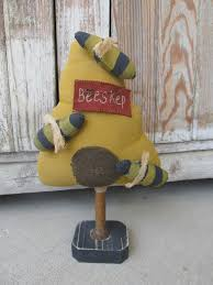 primitive bumble bee hive make do on antique spool