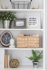 decorating a bookshelf office makeover reveal decorating check and greenery