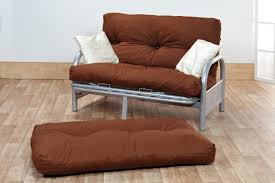 contemporary living room decoration with small futon sofa bed and