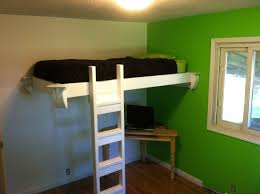 classic kids room design featuring loft beds with long study desk