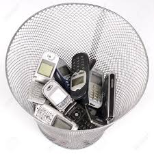 Wastepaper Basket Old Cellphones In The Wastepaper Basket Stock Photo Picture And