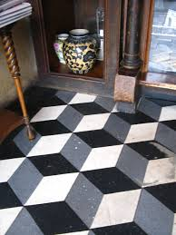pressed concrete terrazzo tile in m c esher 3d box pattern as seen