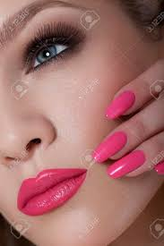 manicure and makeup beautiful woman with pink nails and luxury