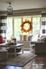 golden boys and me ikea hack fall decor and coffee fall decor in living room with ikea hack plank coffee table and striped drapes www