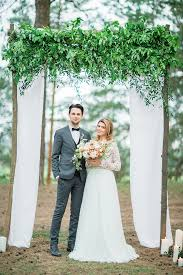 wedding arch greenery woodland wedding inspiration soft tones