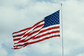 Red Flag Day Free Images Cloud Wind Red Stars And Stripes Flagpole
