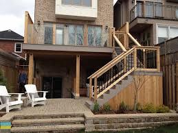 walkout basements pvc deck with glass railings and walkout basement m e