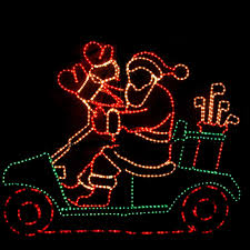 animated waving santa on golf cart light outdoor display