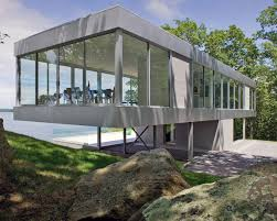 glass wall house panoramic views surround this cantilevered house from all four sides