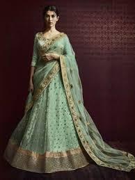 green color heavy embroidered wedding lehenga buy online by nakkashi