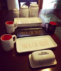 i love these rae dunn halloween mugs and kitchen decor at