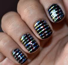 black striping tape nail design on glitter gel nails