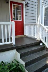porch floor paint using to create a painted rug and numbered steps