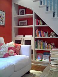 11 great storage ideas for wasted space beneath your stairs