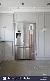 stainless steel kitchen cabinet doors uk a stainless steel fridge freezer in a modern white kitchen