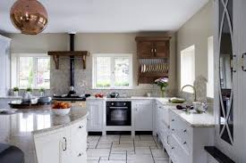classic kitchen with marble countertop wooden plate rack and white
