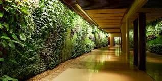 elegant fresh nuance of the a green wall with flowers that has