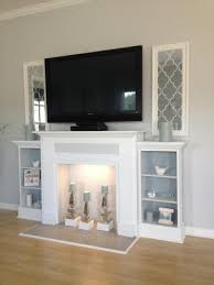 love this faux mantle with candles and side shelves for a