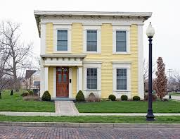 italianate style house yellow italianate square house front stock photo image of home