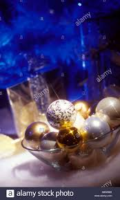 medium up of gold silver and white ornaments in a glass bowl