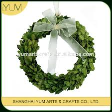 different sizes of preserved boxwood wreath with white silk bow