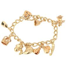 gold bracelet with charms images Pre owned 9ct yellow gold charm bracelet charms jewellery from jpg