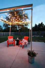 diy string light pergola define your outdoor space