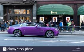 purple rolls royce london uk 5 april 2016 a rolls royce wraith passes harrods