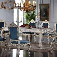 stunning blue upholstered chairs and antique white dining table